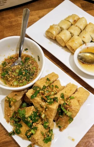 Fried tofu with peanut-herb chili sauce and spring rolls with sweet and sour sauce