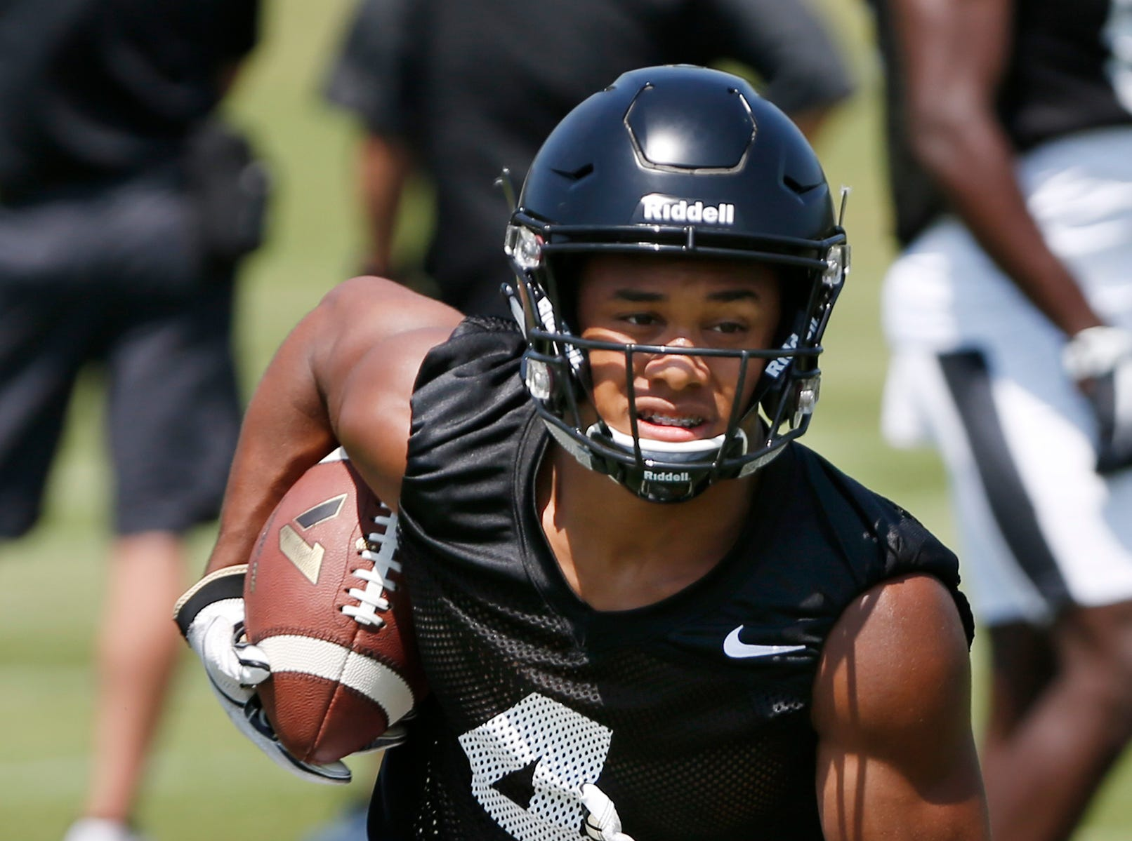 Wide receiver Rondale Moore runs after catching a pass during football practice Thursday, August 2, 2018, at Purdue.