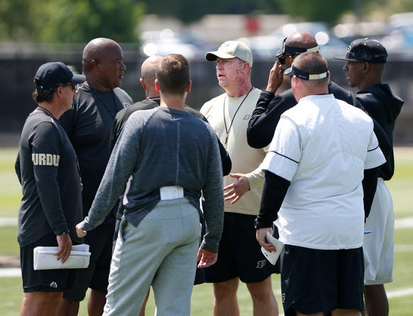 Head coach Jeff Brohm meets with his coaching staff at the start of football practice Thursday, August 2, 2018, at Purdue.
