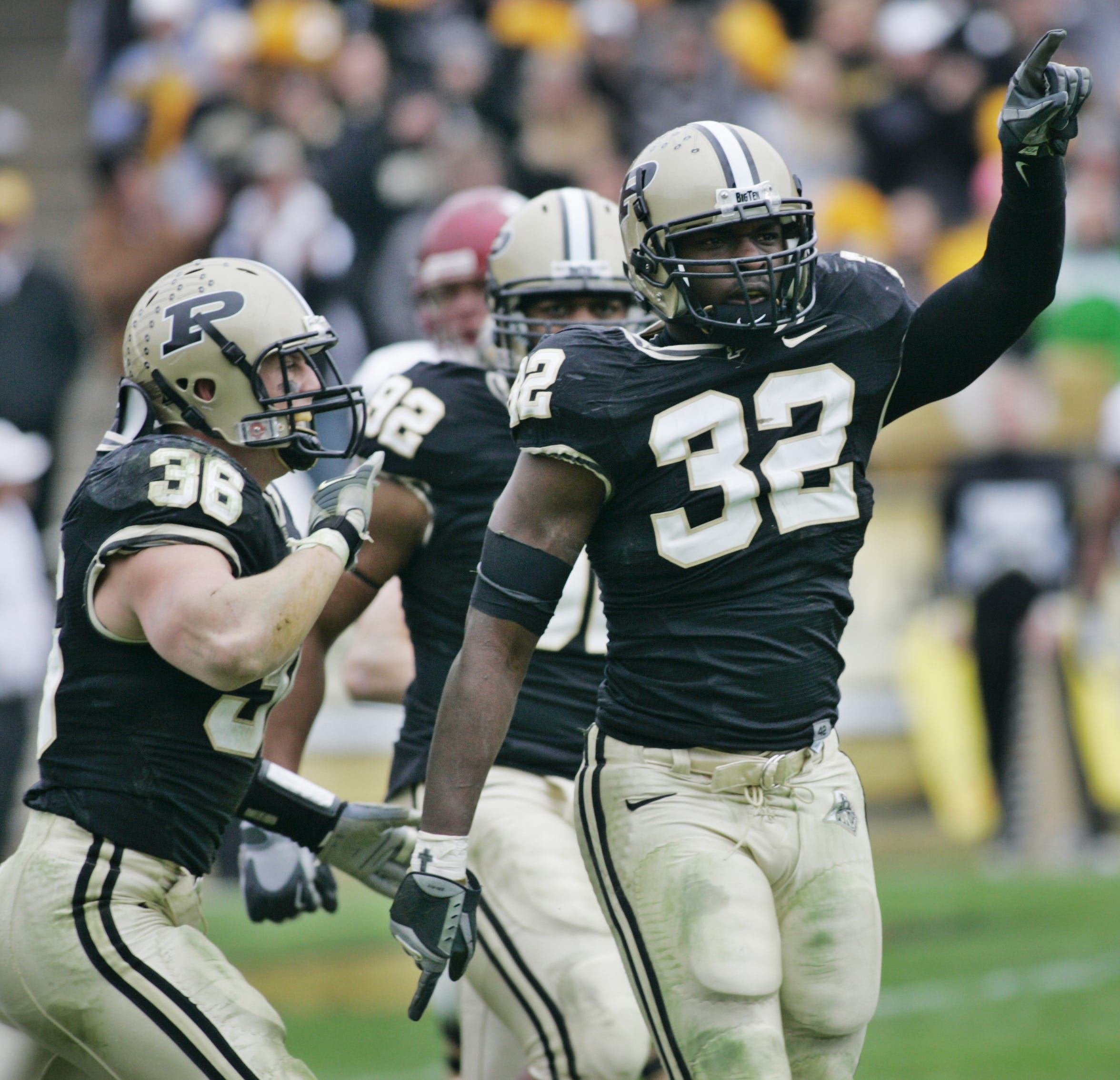 Cliff Avril (32) celebrates stopping Indiana quarterback Kellen Lewis as he tried to run for a two point conversion at 9:29 of the fourth quarter at Ross-Ade Stadium Saturday, November 18, 2006. Purdue defeated Indiana 28-19 to retain the Old Oaken Bucket.