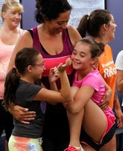 Teresa Catalan, center hugs her niece Ava Catalan, left and daughter Korissa Catalan Friday, July 27, 2018, during a self defense class at the Fairfield County Sheriff's Office in Lancaster. The class was part of a voluntary program developed by female officers in the Fairfield County Common Pleas Court Adult Community Control Department as a way to empower women under their supervision. Teresa, who is on community control, said she brought the two girls with her because they would get something from it as well.