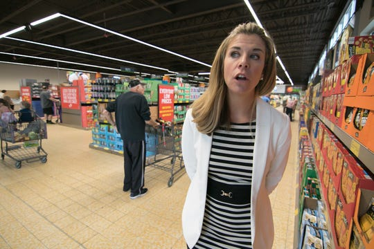 Aldi Director of Operations for Michigan Heather McCarthy talks about improvements to a newly remodeled store in Genoa Township near Howell on their reopening day Thursday, Aug. 2, 2018.