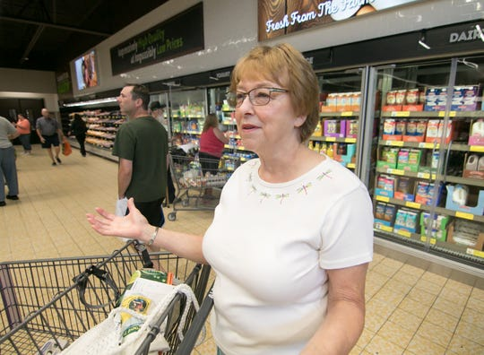 Oceola Township resident Judy McIntosh talks about things she enjoys about the Aldi grocery store in Genoa Township on its reopening day, Thursday, Aug. 2, 2018.
