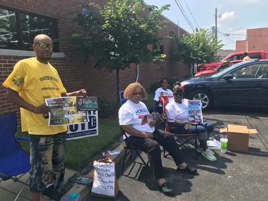 Phillip King, left, Teresa Boyd, right, and Shelia Smith, back, gather outside Mt. Nebo Baptist Church during Thursday's election.