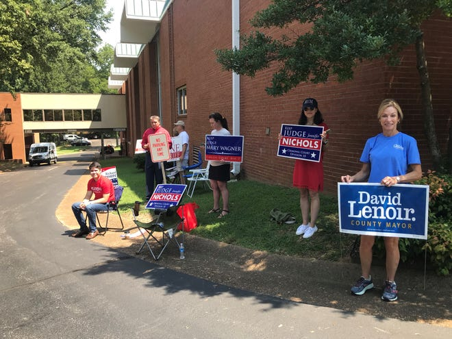 A group of people greet fellow voters Thursday afternoon at Second Baptist Church.