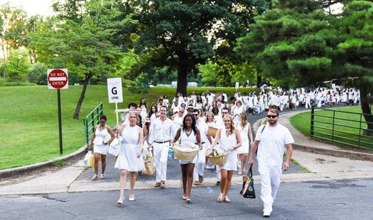 Guests at Le Dîner en Blanc bring their own picnic supplies.