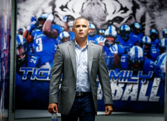 University of Memphis head coach Mike Norvell makes his way to a press conference during football media day at the team facility on the South Campus.