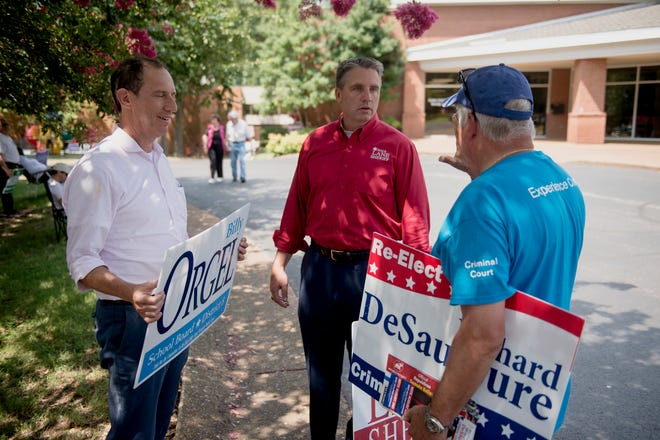 August 2, 2018 - School Board candidate Billy Orgel, from left, Shelby County Criminal Court Clerk candidate Richard Desaussure, and Shelby County Sheriff candidate Dale Lane stand outside Second Baptist Church during election day.