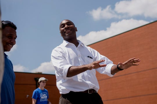 August 2, 2018 - State Senator Lee Harris, Democratic candidate for Shelby County Mayor, talks with voters and campaign workers at Cordova High School during election day.