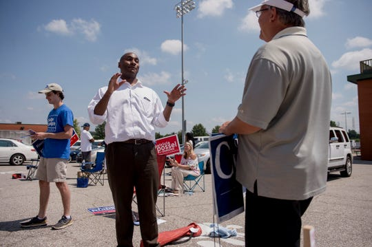 August 2, 2018 - State Senator Lee Harris, center, Democratic candidate for Shelby County Mayor, talks with David Lenoir supporter Milton Rodgers, right, at Cordova High School during election day.