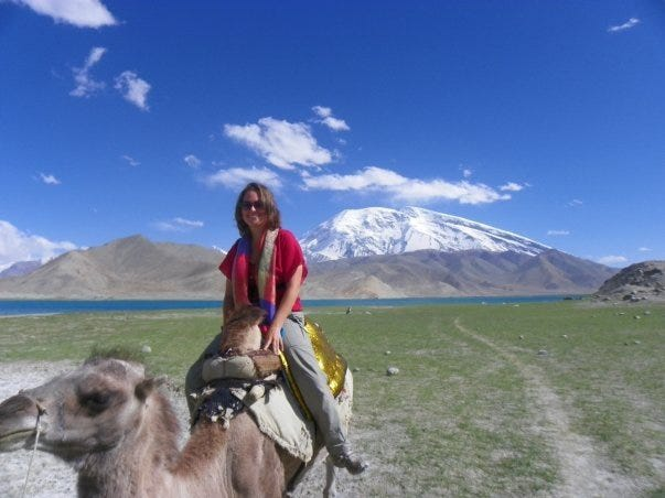 Riding a camel near the Pakistani border in western China. Heather Woodward, daughter of Marco Islander Craig Woodward, has lived all over Asia and traveled all over the world.