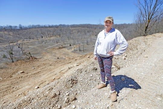 Danah Zoulek stands on a pile of clean fill on her property in Colgate. After months of legal battles with the Village of Richfield, Zoulek is finally taking clean fill at her quarry reclamation project.
