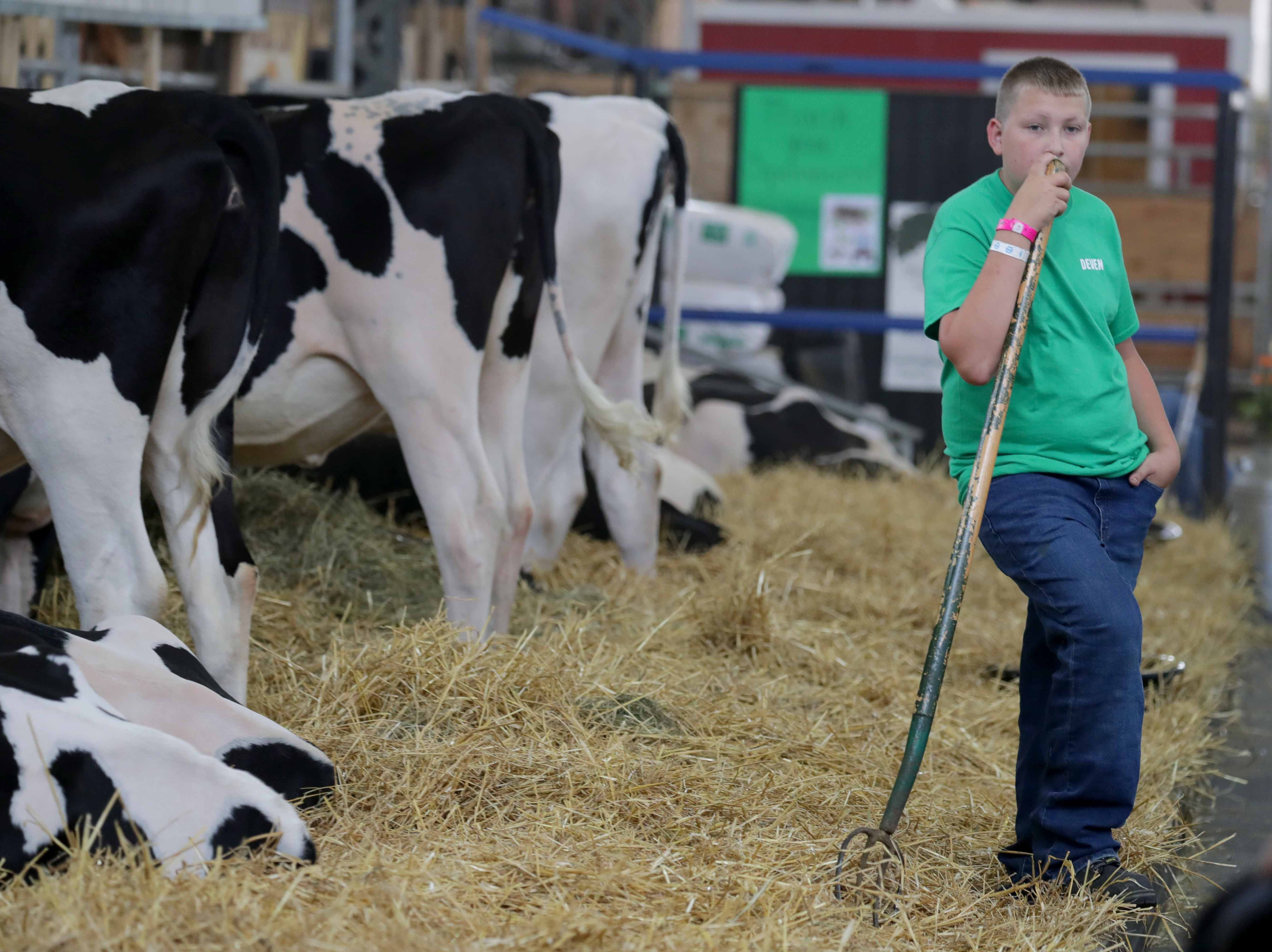 W-ANIMALS - Deven Gilson, 14, of New Glarus, Wis. and a member of the York 4-H club, takes a break from cleaning up a cattle pen.  Youth from across the area from various 4-H groups and agriculture organizations, descended on the Wisconsin State Fair grounds in West Allis to ready their animals for shows. The opening of the 167th Wisconsin State Fair took place at the Wisconsin State Fair grounds in West Allis on Thursday, August 2, 2018. The fair runs through Sunday, August 12  -  Photo by Mike De Sisti / Milwaukee Journal Sentinel