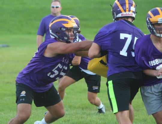 New Berlin Eisenhower senior Mark Shields works on the offensive line during practice on August 1.