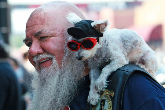 Jim Carson, and his dog Booboo, hang out on Lazelle Street in downtown Sturgis. Booboo was born during the rally 19 years ago. Carson, from Gillette, Wy., has been coming to the event for more than 40 years.