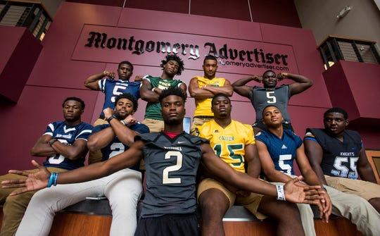 The Montgomery Advertiser Prep Football Top Ten, from left, LaQuez Cain of Park Crossing,Darius Hodges of Park Crossing, Tony Amerson of St. James, Brandon Mack of Jeff Davis, J.D. Martin of Wetumpka, Anthony Scott of Carver, Ke'Shun Brown of Carver, P.J. Lucas of Wetumpka, Collin Duncan of St. James, and C.J. Person of Catholic, are shown during the Montgomery Advertiser High School Football Media Day in Montgomery, Ala., on Thursday, August 2, 2018.