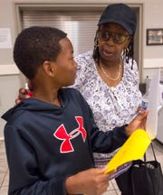 Alchico Grant and his grandmother Antionetta Jackson discuss his sixth-grade class schedule Thursday at Trinity. Grant will attend his fourth year at Trinity on a scholarship from the Alabama Accountability Act.