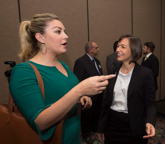 Mallory Hagan, left, Democratic candidate for U.S. Representative District 3, talks with Democratic candidate for U.S. Representative District 2 Tabitha Isner Thursday, Aug. 2, 2018, during the AFL-CIO's endorsement convention in Montgomery, Ala.