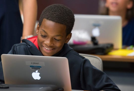 Alchico Grant sits in sixth grade computer orientation class Thursday, Aug. 2, 2018, at Trinity Presbyterian in Montgomery, Ala. Grant will attend his fourth year at Trinity on a scholarship from the Alabama Accountability Act.