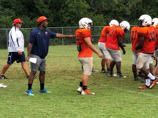 Former Blackman and MTSU star and current Blaze coach I'tavius Mathers works with freshmen running backs during Wednesday's practice.