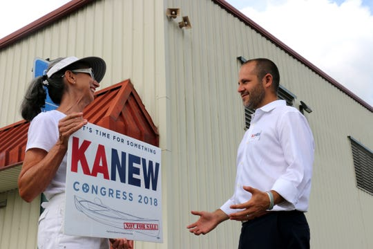 Tennessee Congressional House District 7 candidate Justin Kanew talks with volunteer Loyce Hooker at the Robert E. Ring Soccer Complex on Aug. 2, 2018.
