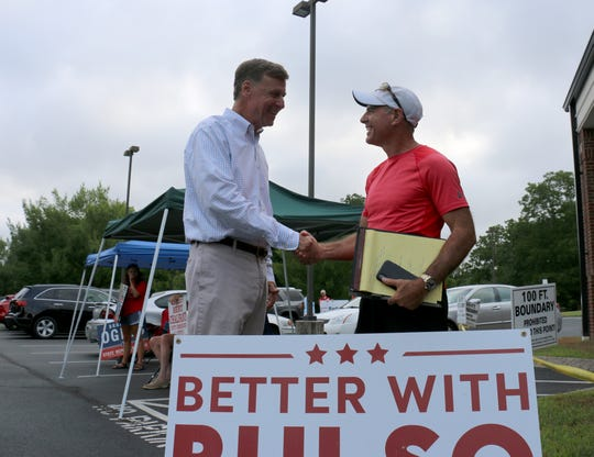 House District 61 candidate Gino Bulso shakes hands with voter Steve Kroeger at the Brenthaven Cumberland Presbyterian Church polling location Aug. 2, 2018.