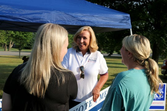 House District 61 candidate Rebecca Burke stands with voters Grace and Madelyn Bomar at the Brenthaven Cumberland Presbyterian Church on Aug. 2, 2018.