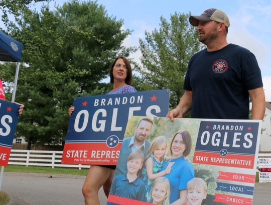 House District 61 candidate Brandon Ogles stands with his wife, Grace, at the Hunters Bend Elementary School polling location Aug. 2, 2018.