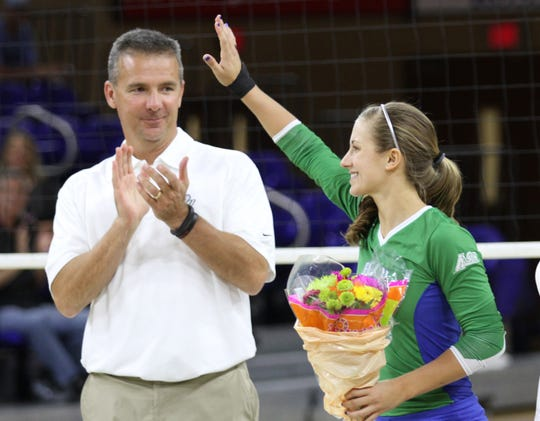 Urban Meyer claps for his daughter Gigi as she is honored during a senior day celebration before FGCU's game against Florida Atlantic in 2014.