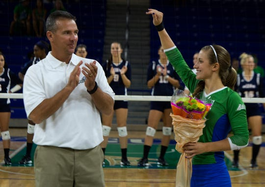 Ohio State football coach Urban Meyer, left, applauds his daughter,  FGCU's Gigi Meyer, an Eagles volleyball player, during Senior Night in 2014 at Alico Arena in Fort Myers.