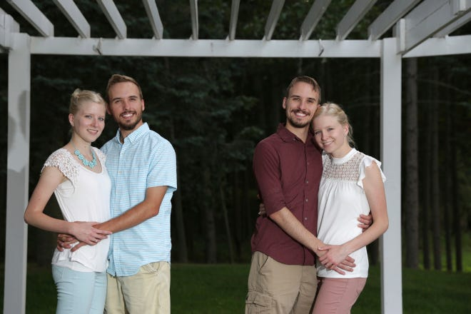 From left, Krissie Bevier and fiance, Zack Lewan and Nicholas Lewan and fiance, Kassie Bevier, pose for a photo, Sunday, July 29, 2018, in Grass Lake. Identical twins Krissie and Kassie Bevier are marrying identical twins, Zack and Nicholas Lewan.