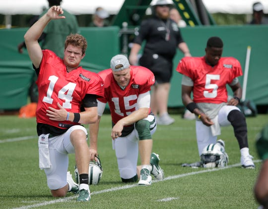 New York Jets quarterbacks Sam Darnold, left, Josh McCown, center, and Teddy Bridgewater stretch during practice at the NFL football team's training camp in Florham Park, N.J., Thursday, Aug. 2, 2018. (AP Photo/Seth Wenig)
