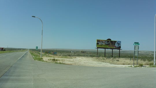 A billboard stands near the entrance to the Carlsbad Caverns National Park, Aug. 1, 2018 at the corner of Dark Canyon Road and National Parks Highway.