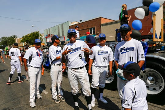 Members of Farmington Fuel participate in the Connie Mack World Series Parade, Thursday, August 2, 2018 on Main Street in downtown Farmington.