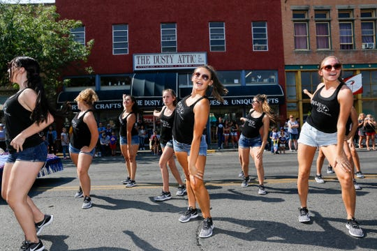 Members of the Piedra Vista High School Panteraz perform Thursday during the Connie Mack World Series Parade on Main Street in downtown Farmington.