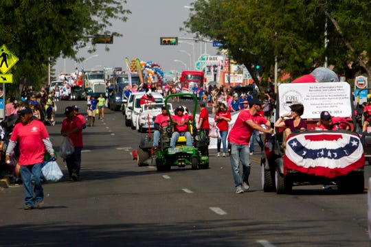 Participants in the Connie Mack World Series parade proceed down West Main Street Thursday in downtown Farmington.
