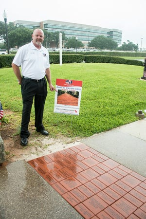 Richard Penrose, a member of the Veterans Memorial Park board, discusses the park's Walk of Honor fundraising program