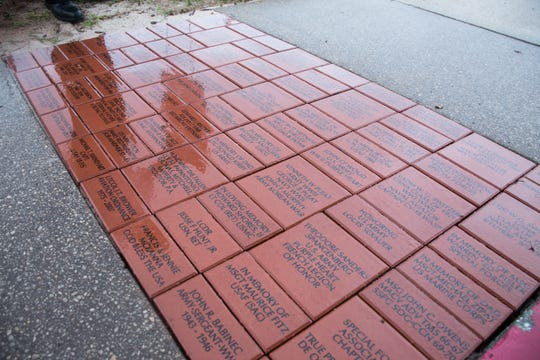 The first commemorative bricks placed as part of the Walk of Honor program to raise money for Pensacola's Veterans Memorial Park.