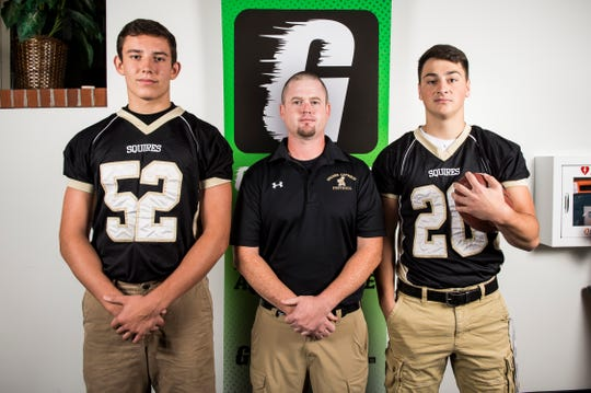Delone Catholic football head coach Corey Zortman poses for a photo with players Andrew Shipley, left, and Tyler Monto during YAIAA football media day in Hanover on Thursday, August 2, 2018.