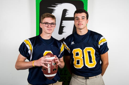 Littlestown's Jakob Lane, left, and Jacob Thomas pose for a photo during YAIAA football media day in Hanover on Thursday, August 2, 2018.