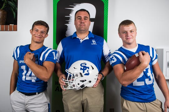 Spring Grove football head coach Kyle Sprenkle poses for a photo with players Nick Shaqfeh, left, and Eric Glass during YAIAA football media day in Hanover on Thursday, August 2, 2018.