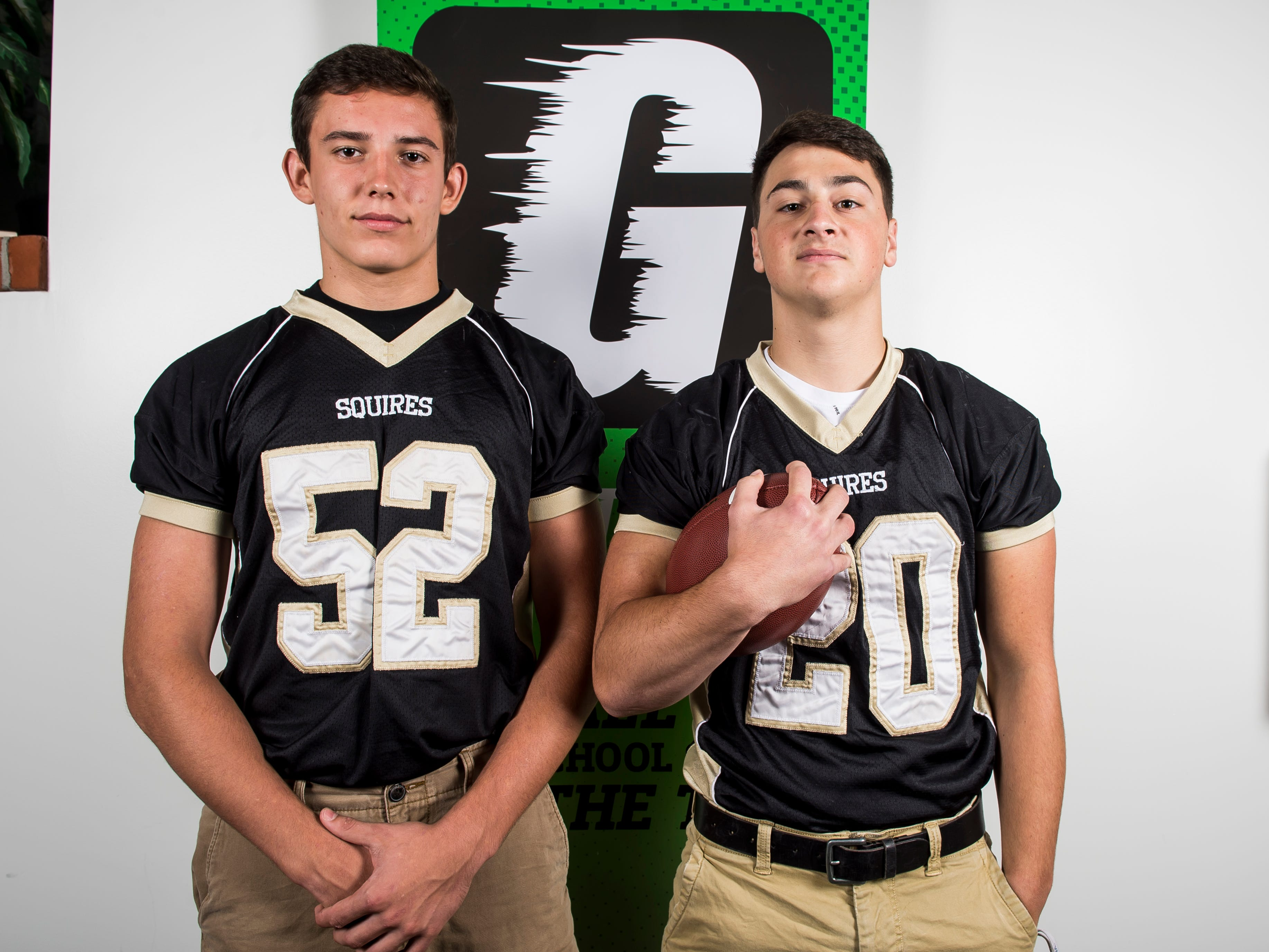 Delone Catholic football players Andrew Shipley, left, and Tyler Monto pose for a photo during YAIAA football media day in Hanover on Thursday, August 2, 2018.