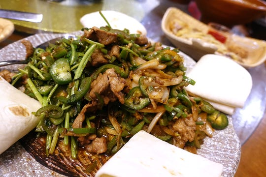 Double flavors flying lamb with chiles, cilantro and tortillas at Shaanxi Garden in Mesa.