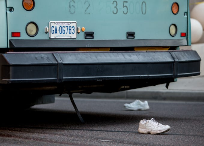 A pedestrian's shoes are seen on August 1, 2018, after being struck by a city bus on the corner of 1st Avenue and East Van Buren Street.