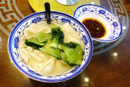 Dip noodles in garlic sauce at Shaanxi Garden in Mesa.