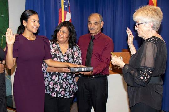Mayor Thelda Williams swears in interim councilwoman Vania Guevara, standing with her family, on Aug. 1, 2018.