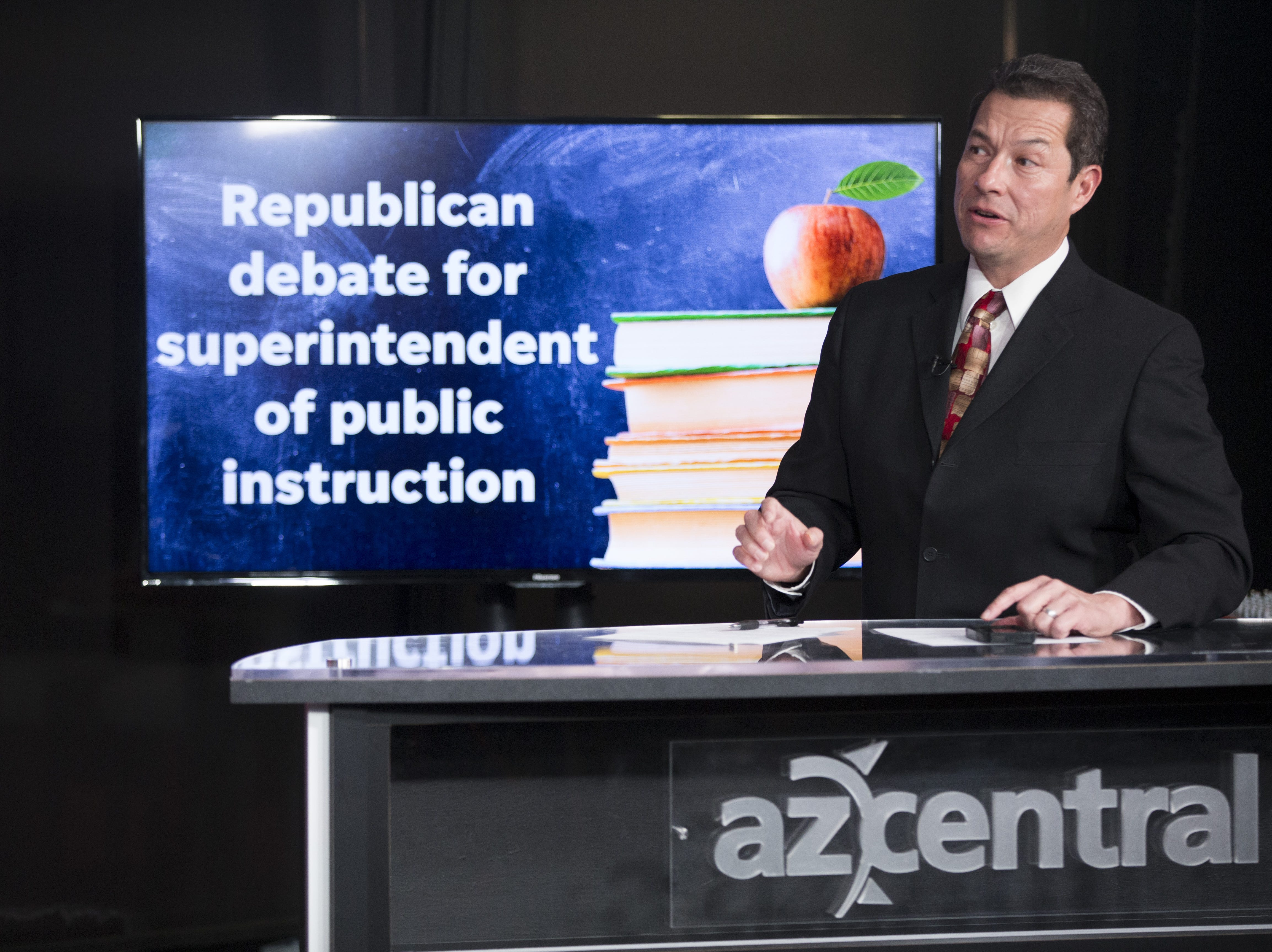 Arizona Republic reporter Richard Ruelas hosts five GOP candidates for state superintendent of public instruction during a debate on August 1, 2018.