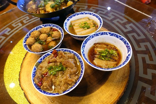 Four bowls of happiness (clockwise from bottom left: braised beef, pork meatballs, marinated tofu and pork belly) at Shaanxi Garden in Mesa.