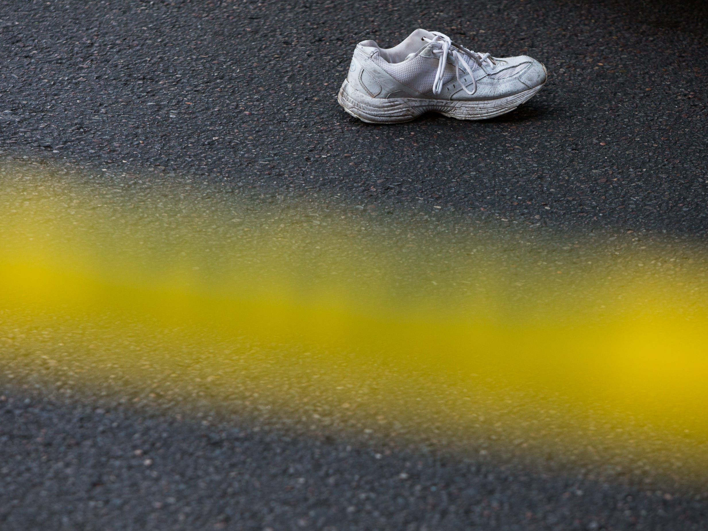 A pedestrian's shoe lies in the street on August 1, 2018, after being struck by a city bus on the corner of 1st Avenue and East Van Buren Street.
