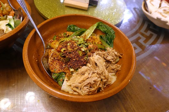 Spicy oil seared noodles with braised pork, vegetables and dry spice at Shaanxi Garden in Mesa.